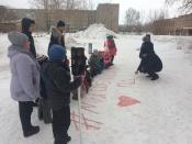 Назаровские дошкольники к соблюдению правил призывают через граффити на снегу