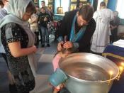 13 назаровских детей с ограниченными возможностями крестились в Покровском храме